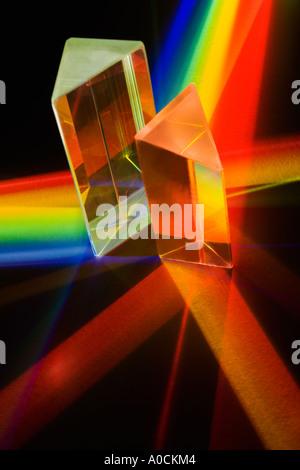 Light passing through two prisms - Stock Photo