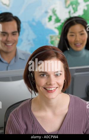 Phone operators using headsets - Stock Photo