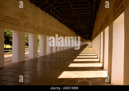 Stock photograph of an interesting perspective walkway at the Shwezigon Paya in Nyaung U in Myanmar 2006 - Stock Photo