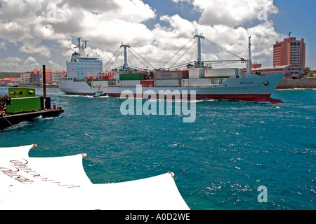 Container ship sailing out of the St Ana Bay in Curacao Netherlands Antilles - Stock Photo