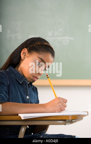 Young girl in classroom - Stock Photo