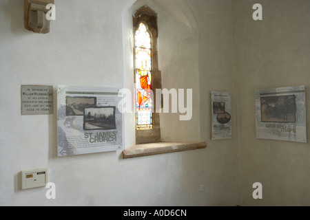 interpretation boards placed in an old chapel to inform tourists - Stock Photo