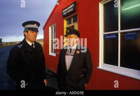 Local policeman and postmaster Haroldswick Post Office Isle of Uist Shetland islands Scotland - Stock Photo