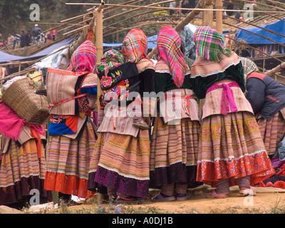 Vietnam Can Cau Flower Hmong hilltribe market women wearing traditional costume crowding around market stall - Stock Photo