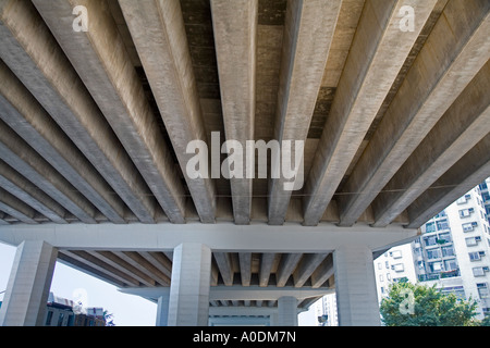 Under giant flyover- North Point Hong Kong - Stock Photo