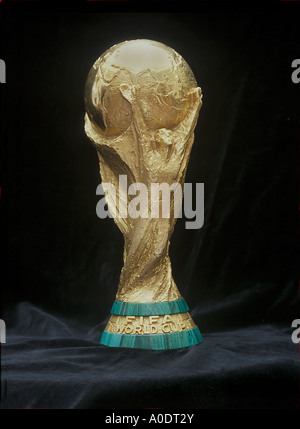 fifa world cup on a blcak background competed for by the football nations of the world On public display in London - Stock Photo