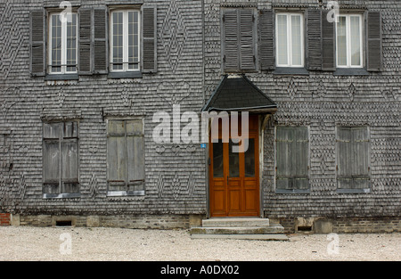 Ancient wooden house wall in provincial town Fragment - Stock Photo
