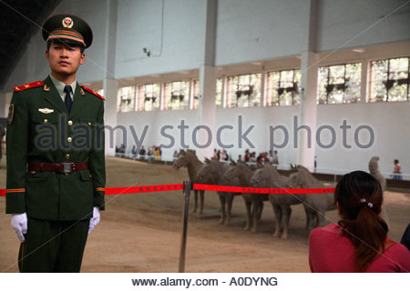 A Chinese Army solidier acts as guard at the Terracotta Warriors museum near Xi'an China - Stock Photo