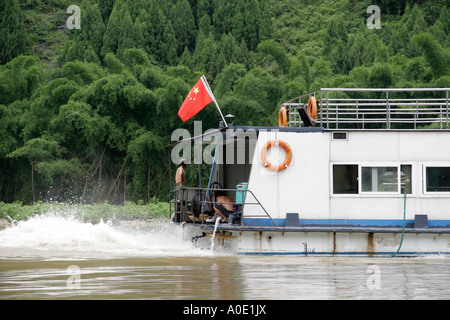 Pleasure boat on the Li River between Guilin and Xingping, Southwest China. - Stock Photo