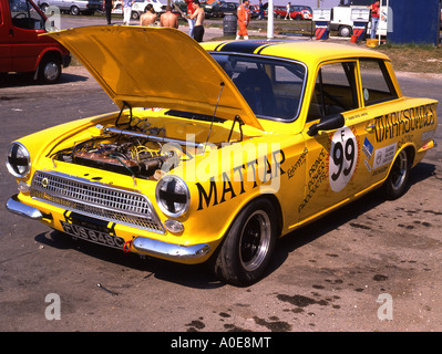 Mark 1 Lotus Ford Cortina racing saloon at Cadwell Park. - Stock Photo