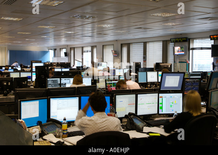 Trading Floor in City Of London, Traders working on computers on computers at London Stock Exchange - Stock Photo