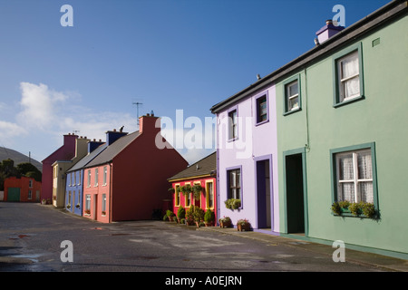 Row of colourful houses in main street of historical village on Ring of Beara tourist route. Eyeries Co Cork Eire - Stock Photo