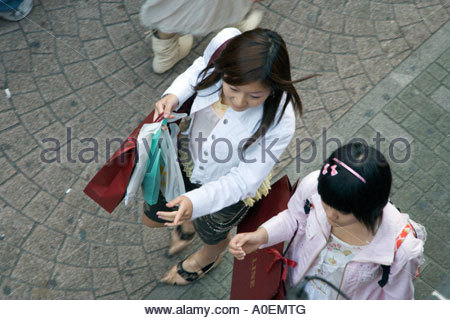 girls shopping in the Harajuku district of Tokyo - Stock Photo