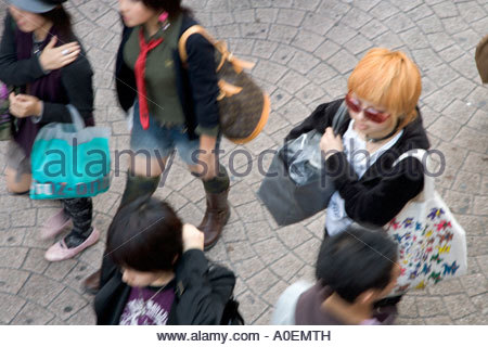 young girls shopping in the Harajuku district of Tokyo - Stock Photo