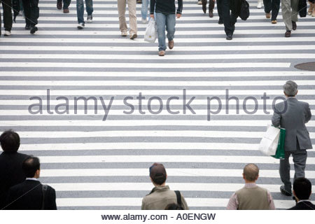 people crossing the Hachiko square zebra crossing at Shibuya station in Tokyo Japan - Stock Photo