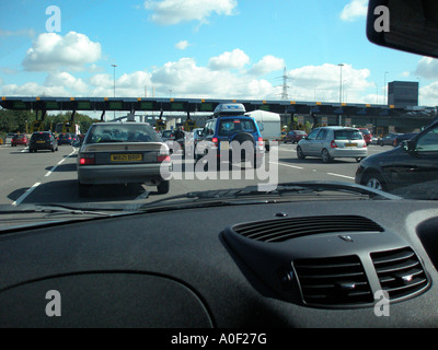 Queues for toll booths at Dartford tunnel - Stock Photo
