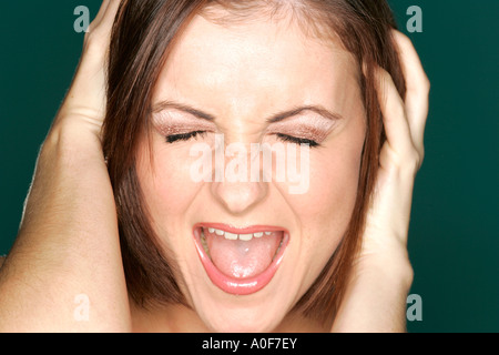Young girl screaming - Stock Photo