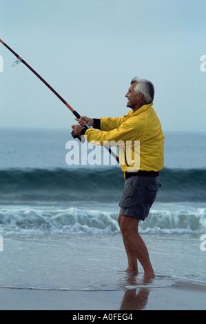 Man In Shorts Surf Fishing Phra Ae Long Beach Ko Lanta