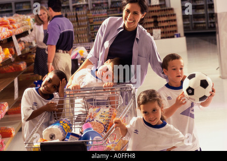 Woman with four children in a department store - Stock Photo