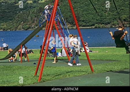 LLANBERIS GWYNEDD NORTH WALES UK August Children making the most of the playground facilities in Padarn Lake Park - Stock Photo