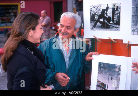 Photographer sells tango pictures in Caminito La Boca Buenos Aires Argentina - Stock Photo