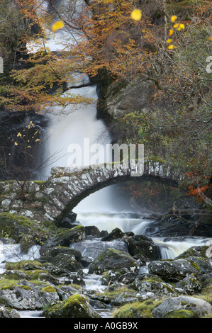Old stone bridge and waterfall in Glen Lyon, Perth and Kinross, Scotland - Stock Photo
