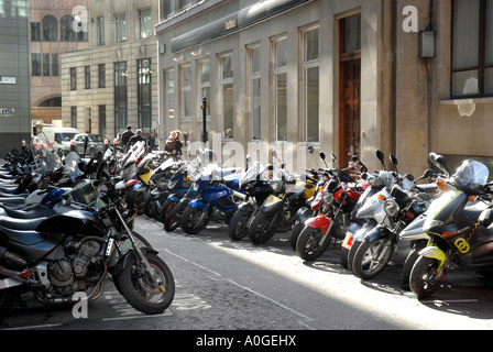 Motorcycles parked in street in the City of London - Stock Photo