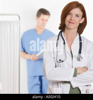 Female doctor smiling confidently - Stock Photo