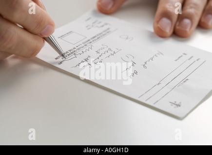 Closeup of hands signing prescription - Stock Photo