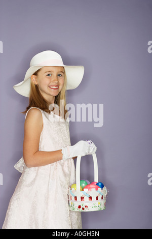 Girl holding a bunch of easter eggs - Stock Photo
