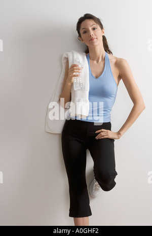 Woman in workout clothes with towel - Stock Photo