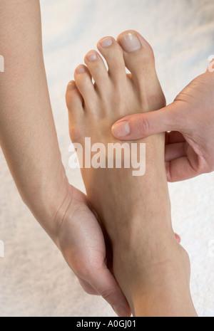 Foot being massaged - Stock Photo