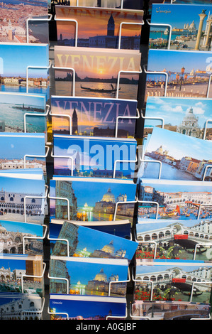 Rack of postcards showing classic tourist scenes in Venice Italy - Stock Photo