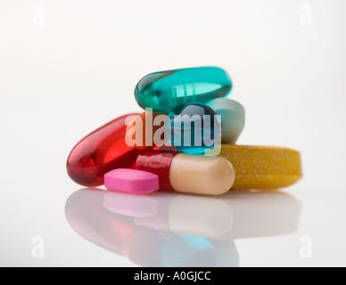 Closeup of pile of multi colored pills - Stock Photo