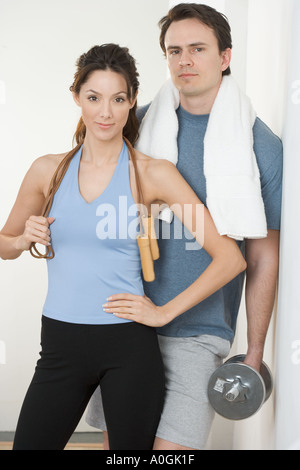 Couple with jump rope towel and weight - Stock Photo