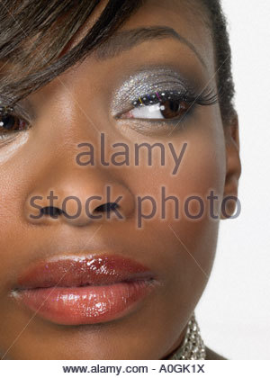 Teenage girl wearing make-up - Stock Photo