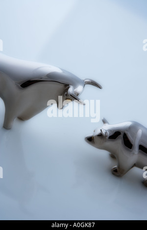 Bull and bear figurines facing off - Stock Photo