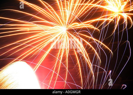bright fireworks in the night sky on Guy fawkes night - Stock Photo