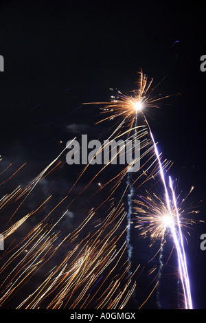 fireworks night display two rockets exploding in the sky - Stock Photo