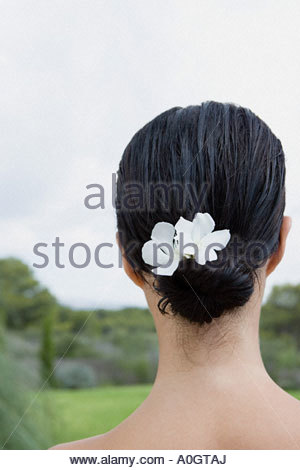 Woman with flowers in her hair - Stock Photo