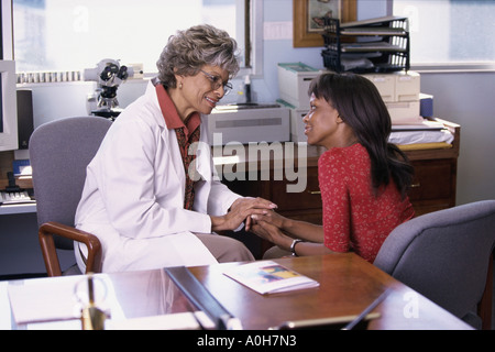 Female doctor talking to a female patient - Stock Photo
