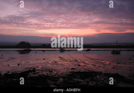 The last rays of early winter sunshine over the Exe Estuary as seen from Topsham near Exeter Devon - Stock Photo