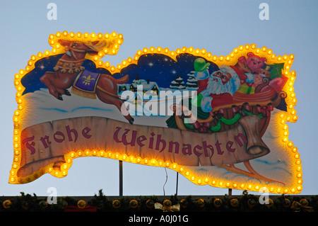 Illuminated ad with Santa Claus, Happy Christmas, Chrismas fair - Stock Photo