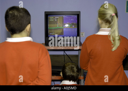 boys and girl playing and watching sonic the hedgehog, retro, game, sega megadrive, computer, game, gaming, gamers - Stock Photo