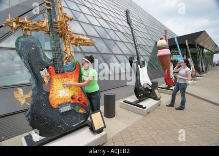 Cleveland Ohio Rock and Roll Hall of Fame GuitarMania teens sisters - Stock Photo