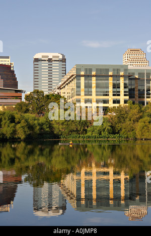 TEXAS Austin Sea kayaker on Town Lake city skyline and office buildings in background reflection in water - Stock Photo