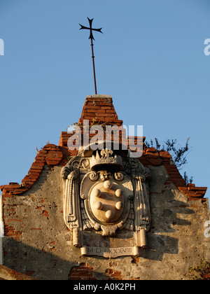 The De Medici Family Emblem On An Old Warehouse Along The Arno River
