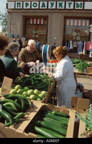 Russia former Soviet Union St. Petersburg produce vendor customer near Metro station entrance - Stock Photo