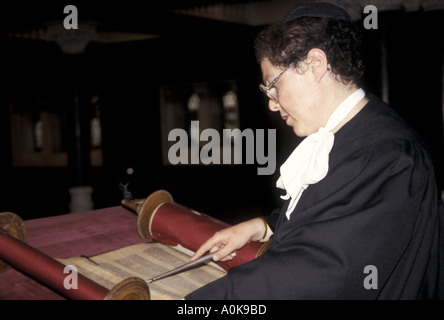 A woman rabbi reading from the sacred scrolls in a British synagogue - Stock Photo