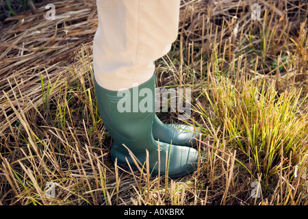 close up of person in wellington boots - Stock Photo